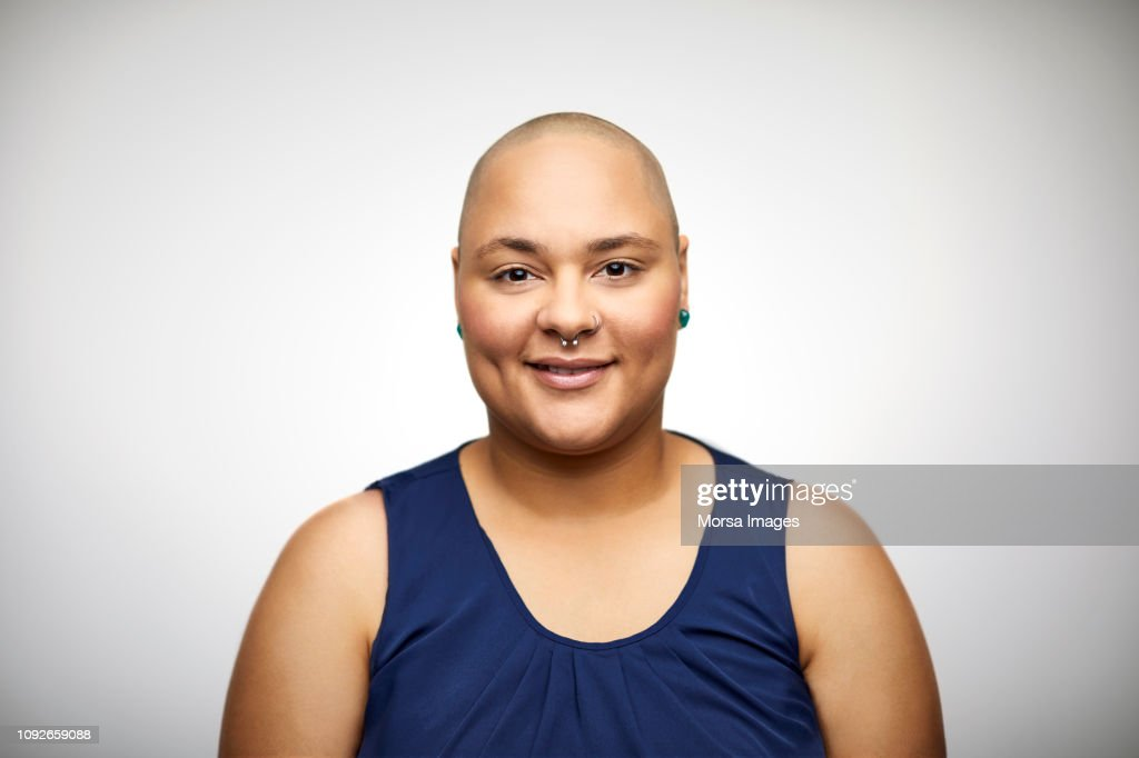 Portrait of confident woman with shaved head : Stock Photo