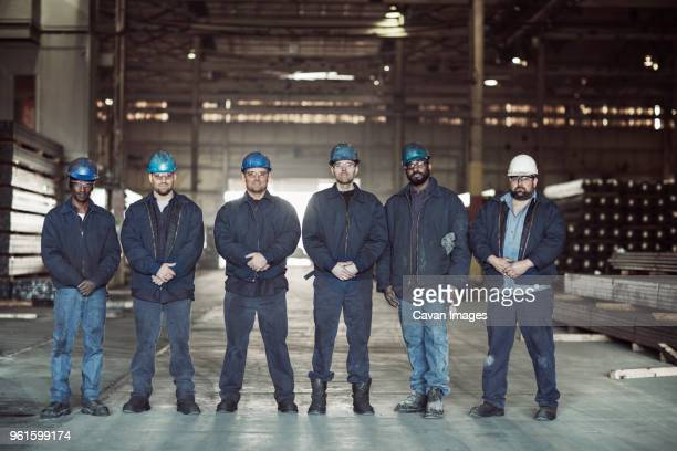 portrait of confident workers in factory warehouse - 数人 ストックフォトと画像
