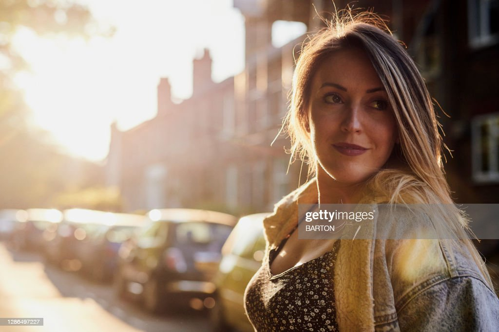 Portrait of confident young adult woman : Stock Photo