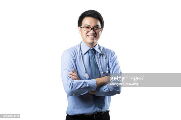 Portrait of confident young asian handsome doctor isolated on white background