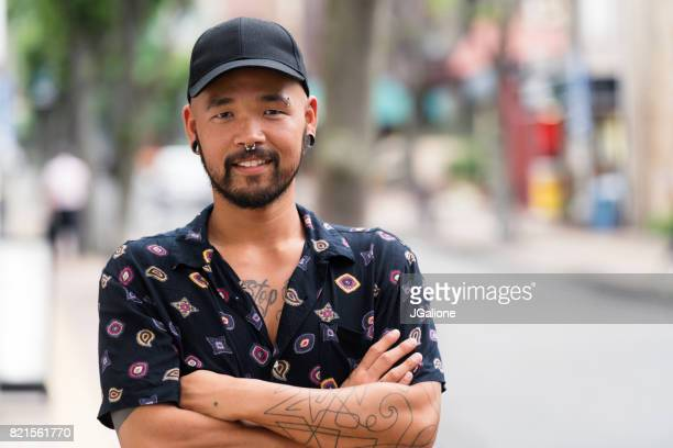 portrait of confident young asian man - punk person stock pictures, royalty-free photos & images