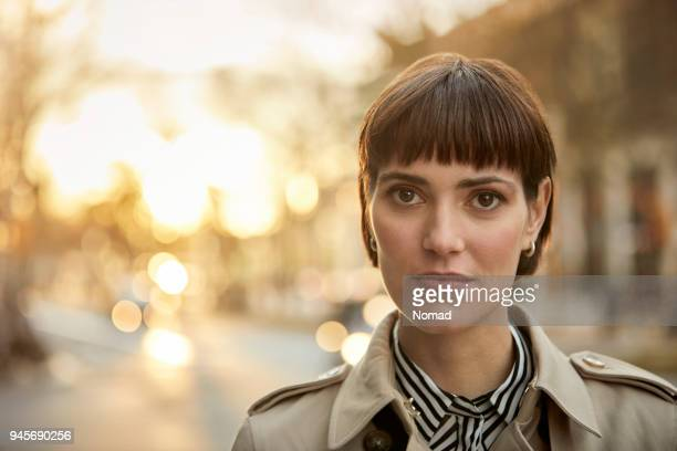 portrait of confident young businesswoman in city - short hair stock pictures, royalty-free photos & images