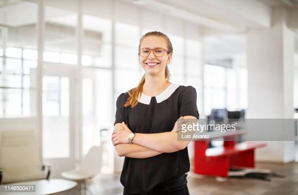 portrait of confident young businesswoman - differential focus stock pictures, royalty-free photos & images
