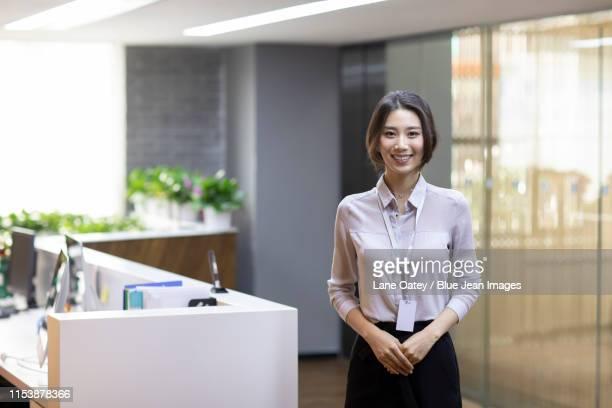 portrait of confident young businesswoman - オープンネック ストックフォトと画像
