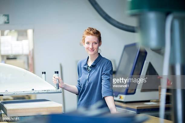 portrait of confident young female shoemaker in workshop - schuhmacher stock-fotos und bilder
