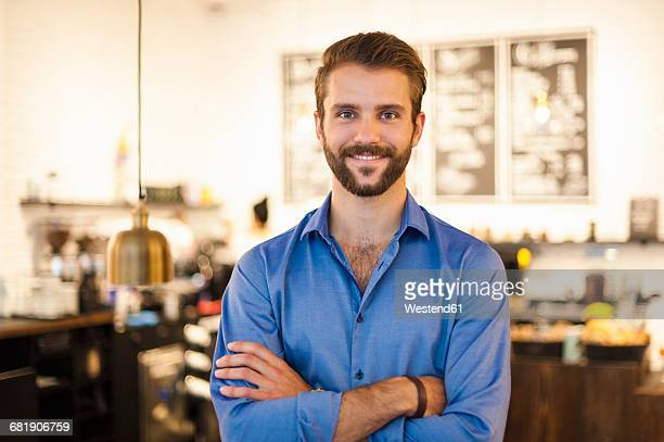 Portrait of confident young man in a cafe