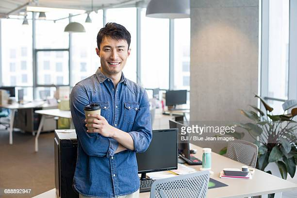 Portrait of confident young man in office
