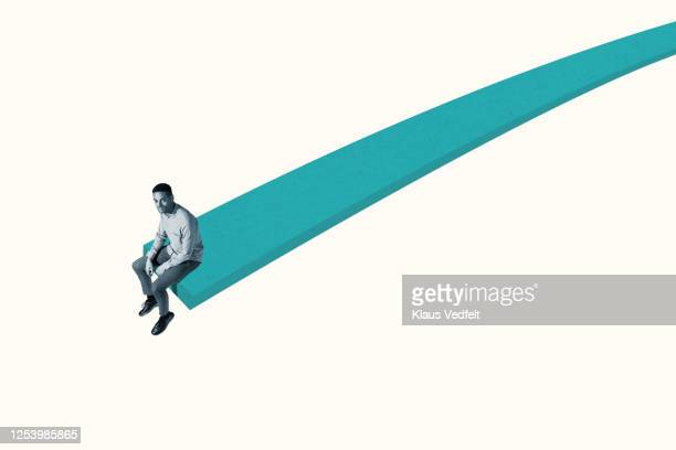 portrait of confident young man on turquoise ramp - oresund region stock pictures, royalty-free photos & images