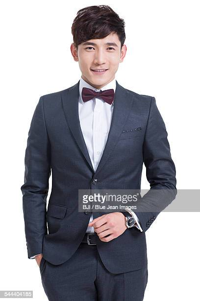 portrait of confident young man - 蝶ネクタイ ストックフォトと画像