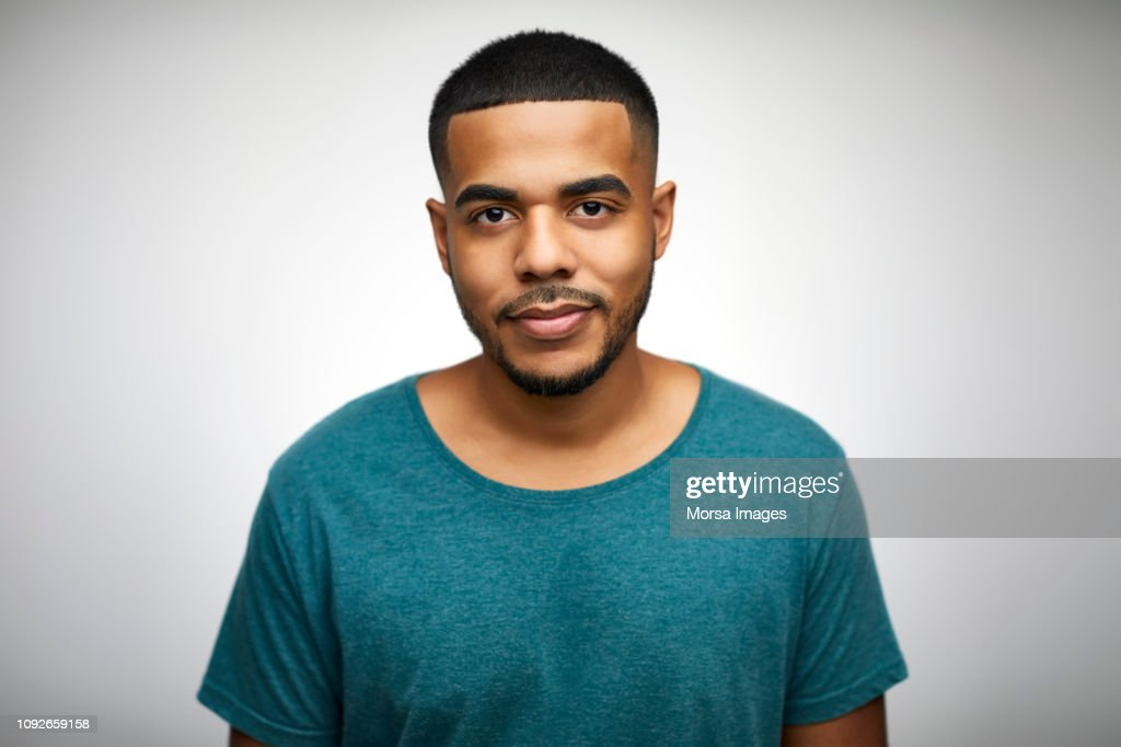 Portrait of confident young man wearing t-shirt : Stock Photo