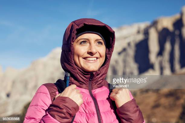 portrait of confident young woman hiking in the mountains - jacket stock pictures, royalty-free photos & images