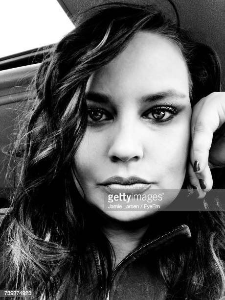 Portrait Of Confident Young Woman In Car