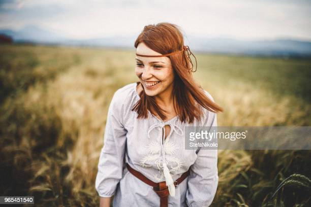 portrait of confident young woman in nature - beauty in nature stock pictures, royalty-free photos & images