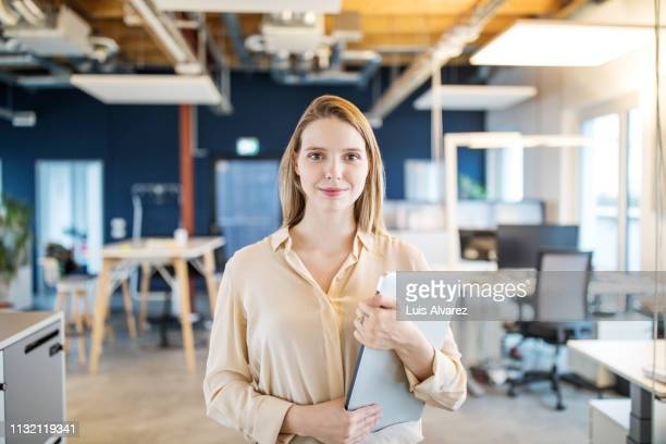 Portrait of confident young woman in office