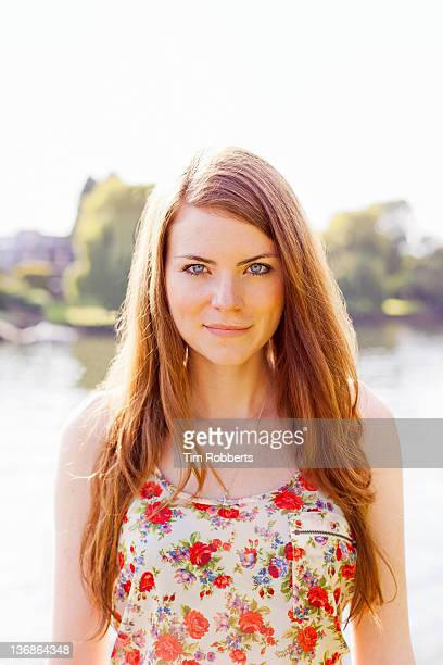 portrait of confident young woman. - newpremiumuk stock pictures, royalty-free photos & images