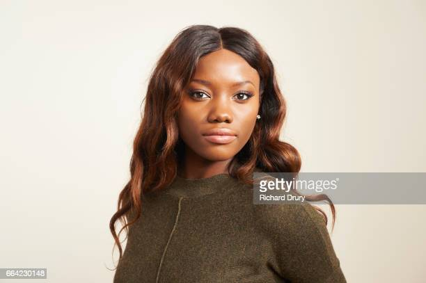portrait of confident young woman - serious stock pictures, royalty-free photos & images