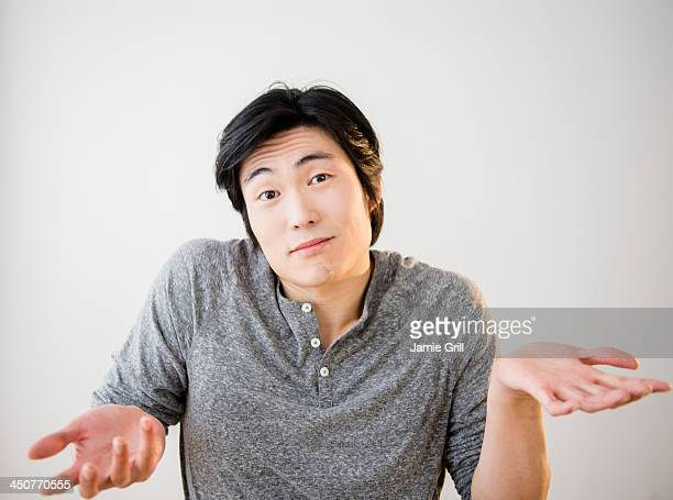 portrait of confused young man - reconciliation stock photos and pictures