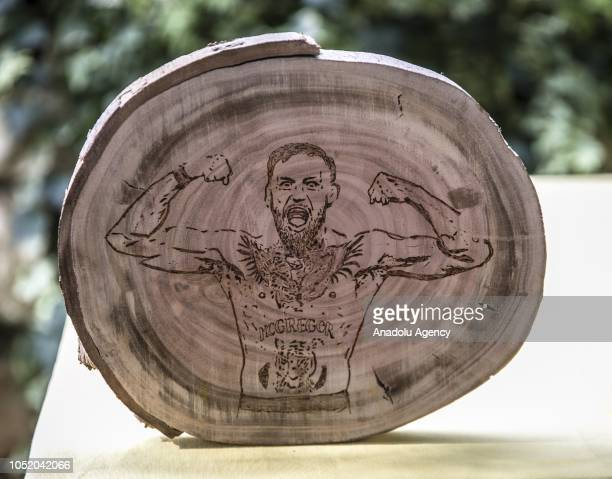 A portrait of Conor McGregor burned on a piece of wood by cook Halil Bozkurt is seen in Turkey's Hatay on October 13 2018 Bozkurt uses wood burning...