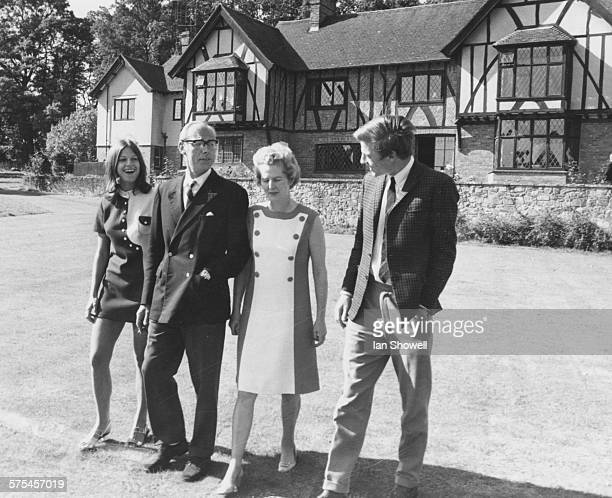 Portrait of Conservative Party leader Margaret Thatcher with her husband Denis and twins Mark and Carol in the garden of their home in Lamberhurst...
