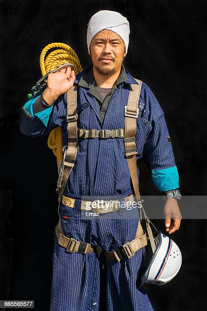 Portrait of  Construction craftsman with a rope