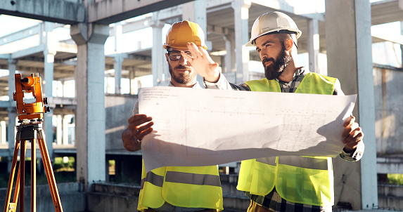 Portrait of construction engineers working on building site 1126121998