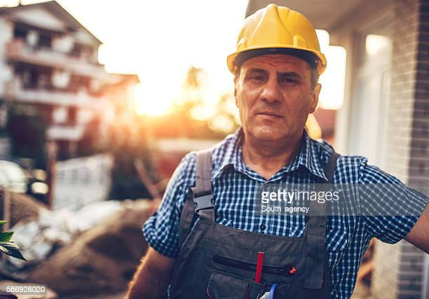 portrait of construction worker - yellow hat stock pictures, royalty-free photos & images