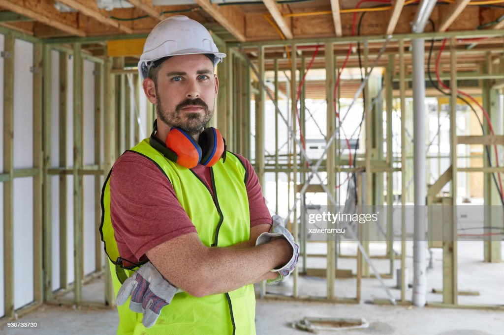Portrait of construction worker with arms crossed : Stock Photo