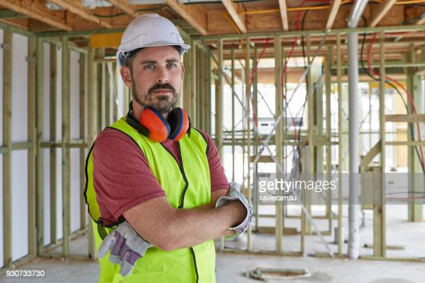 Portrait of construction worker with arms crossed