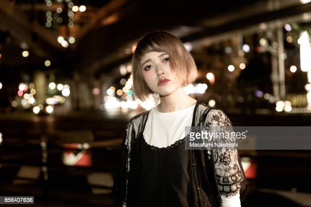 Portrait of Contemporary Japanese young woman on the night street