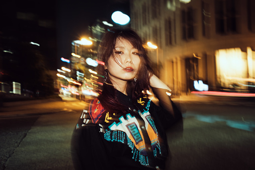 Portrait of contemporary young Japanese woman at night street - gettyimageskorea