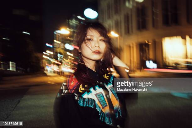 portrait of contemporary young japanese woman at night street - fashionable stock pictures, royalty-free photos & images