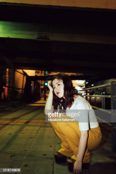Portrait of contemporary young Japanese woman at night street
