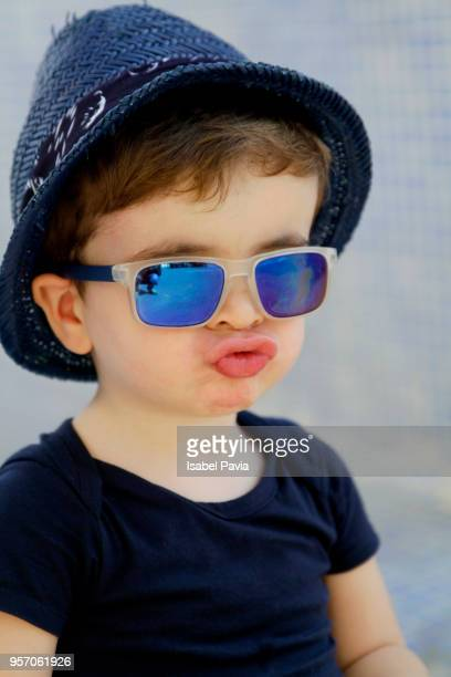 portrait of cool baby boy sending kisses to camera. - baby boys stock pictures, royalty-free photos & images