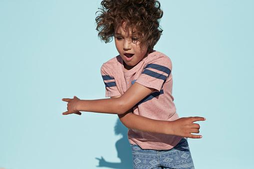 portrait of cool boy dancing, on studio background - gettyimageskorea