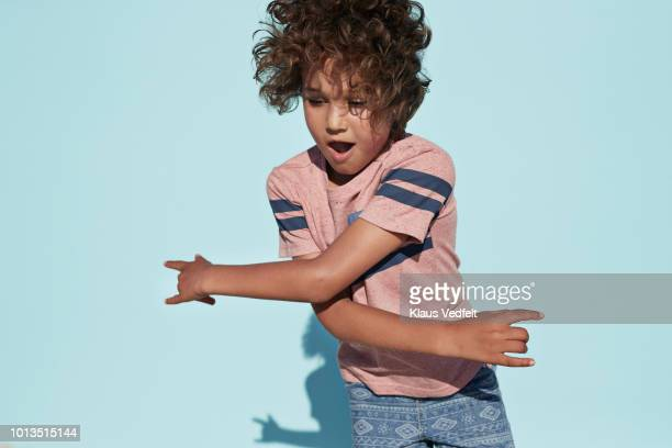 portrait of cool boy dancing, on studio background - innocence stock pictures, royalty-free photos & images
