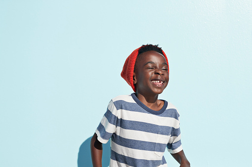 Portrait of cool boy laughing , on studio background - gettyimageskorea