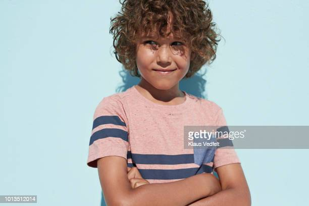 portrait of cool boy looking in camera and smiling - only boys stock pictures, royalty-free photos & images