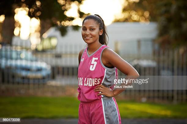 Portrait of cool female basket player