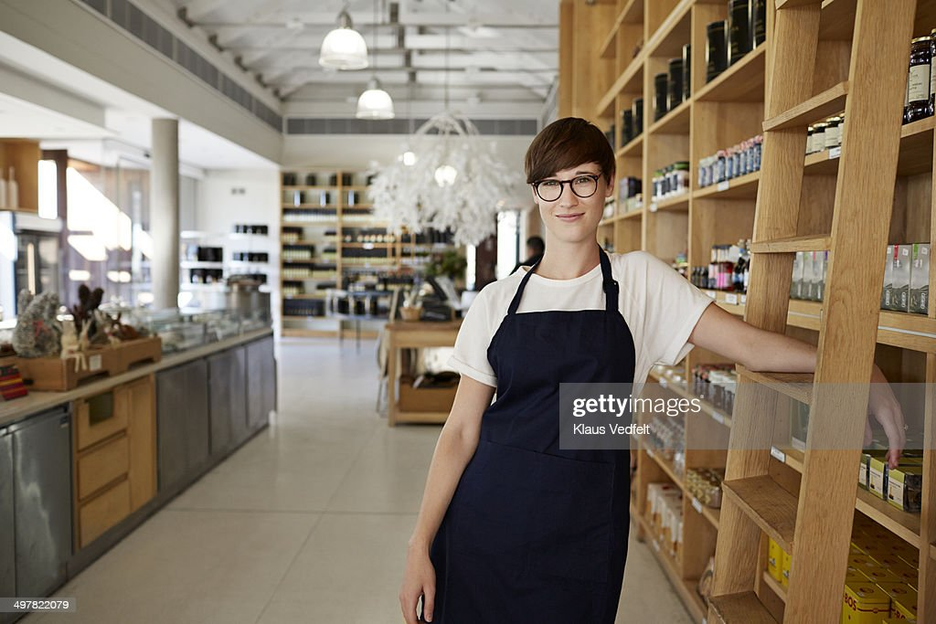 Portrait of cool female deli shop clerk : Stock Photo