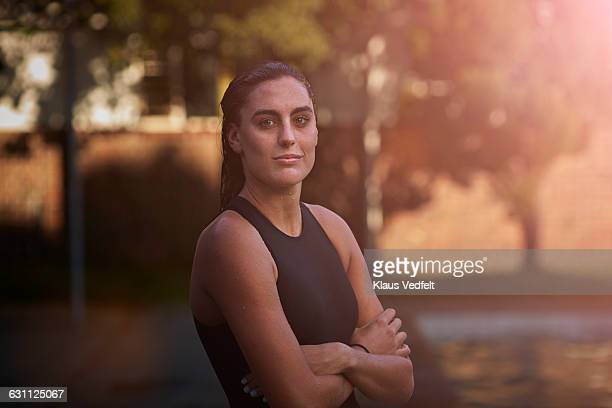 Portrait of cool female swimmer with crossed arms
