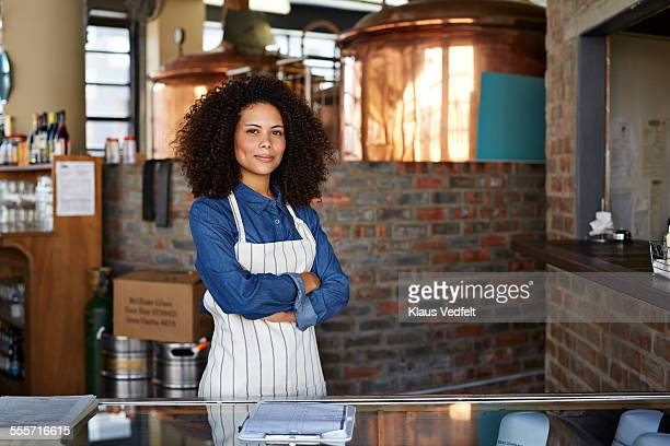 Portrait of cool female waiter at microbrewery