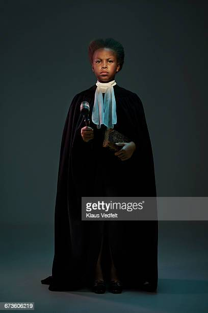 Portrait of cool girl dressed as a judge
