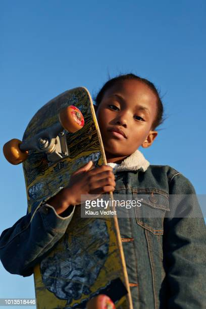 portrait of cool girl holding her skateboard - tomboy stock photos and pictures