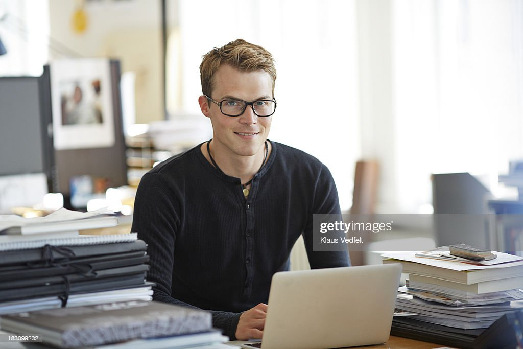 Fine Portrait Of Cool Guy Sitting At Office Desk Stock Photo Download Free Architecture Designs Rallybritishbridgeorg