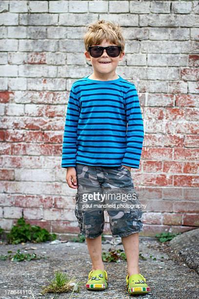portrait of cool looking boy - ボーダーシャツ ストックフォトと画像