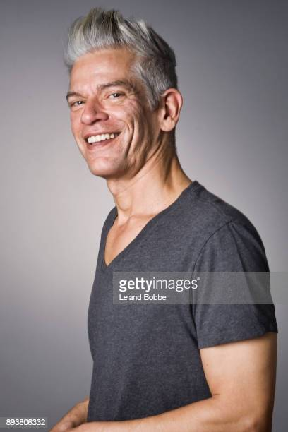 Portrait of Cool Looking Middle Aged Man With Grey Hair