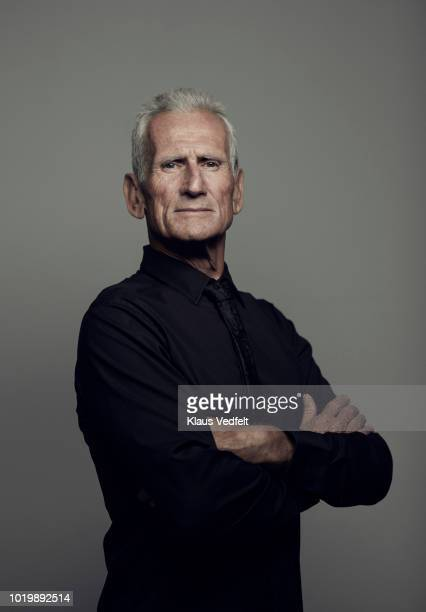 portrait of cool mature man looking in camera - senior stock-fotos und bilder