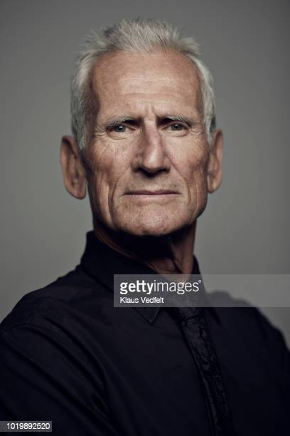 Portrait of cool mature man looking in camera