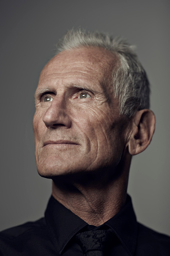 Portrait of cool mature man looking out - gettyimageskorea