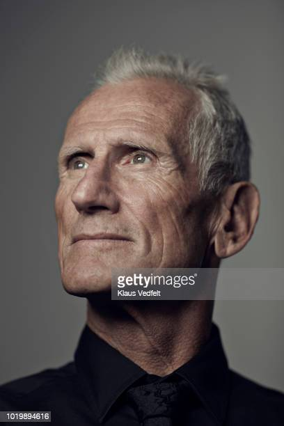 portrait of cool mature man looking out - looking up stock pictures, royalty-free photos & images